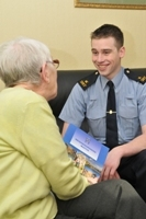 A Community Guard talks to a resident about the Neighbourhood Watch Scheme